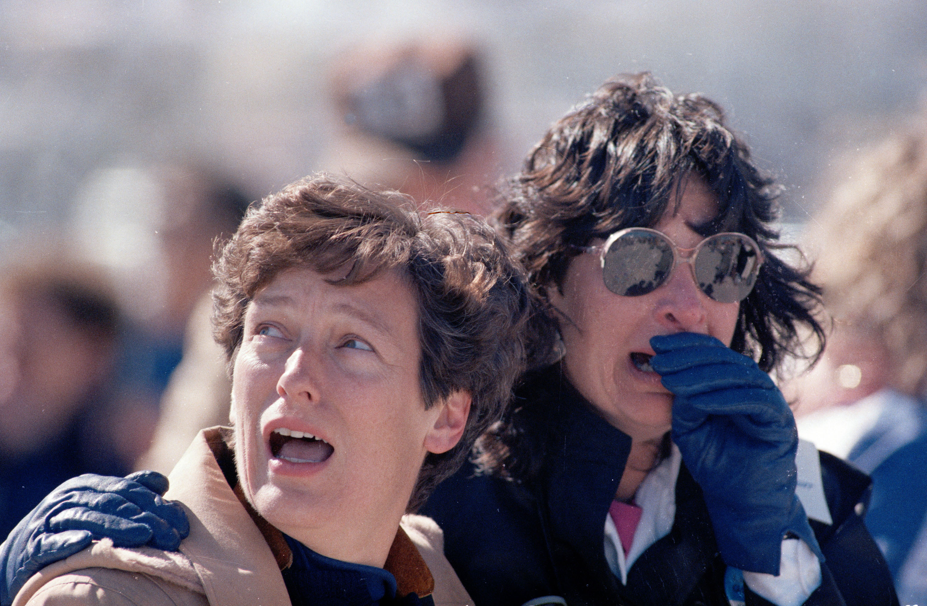 FILE - In this Jan. 28, 1986 file picture, spectators at the Kennedy Space Center in Cape Canaveral, Fla. react after they witnessed the explosion of the space shuttle Challenger. (AP Photo/File)