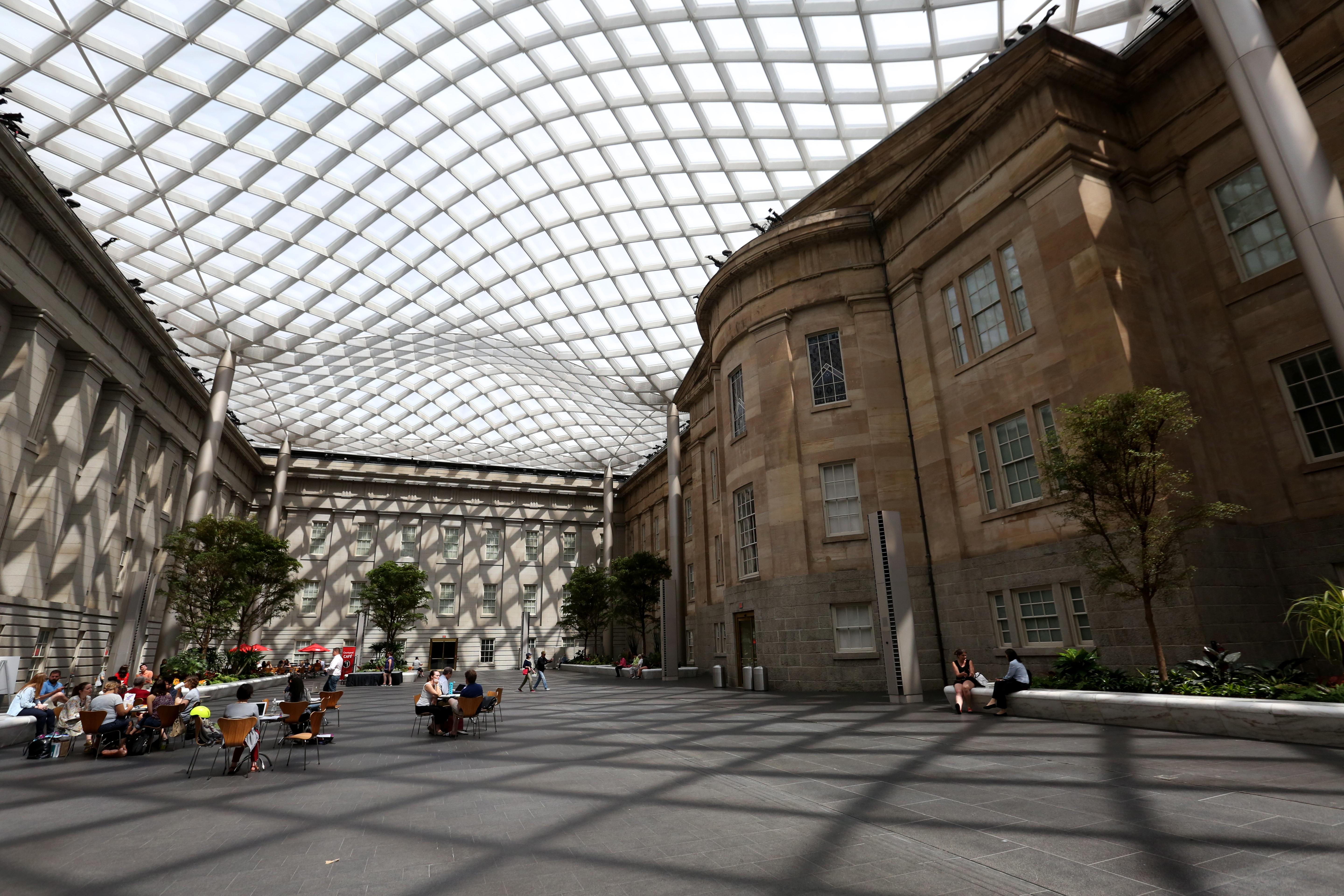 The Robert and Arlene Kogod Courtyard at the National Portrait Gallery is something of an open secret when it comes to perfect reading spots. The covered courtyard lets in a lot of light and there's plenty of space to spread out and read a book.,  especially if you're just trying to sneak away on your lunch break. (Amanda Andrade-Rhoades/DC Refined)