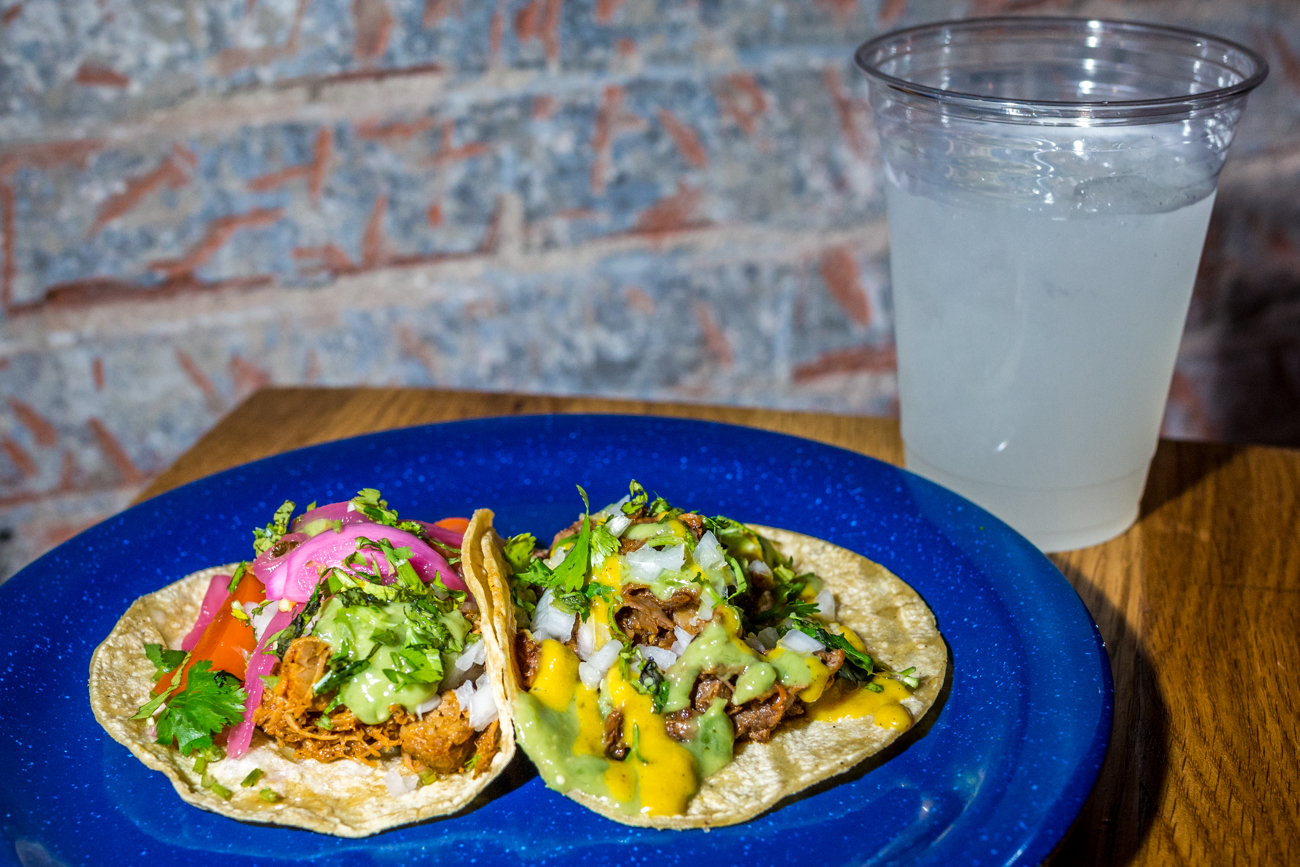 Conchinita (citrus-roasted pork) taco topped with avocado salsa and pickled chilis & a lengua (beef tongue) taco topped with avocado salsa and salsa amarilla / Image: Catherine Viox{ }// Published: 8.31.19
