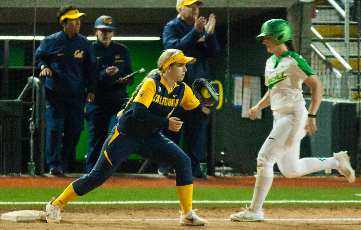 California infielder Bradie Fillmore (#4) catches the ball before tagging out Oregon utility player Lauren Lindvall (#8). In the first of a three game series the Oregon Ducks defeated the California Golden Bears five to one. Photo by Ben Lonergan, Oregon News Lab