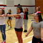 14-year-old with Down syndrome brings energy to cheerleading squad