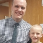 Heartland principal shaves head to comfort student