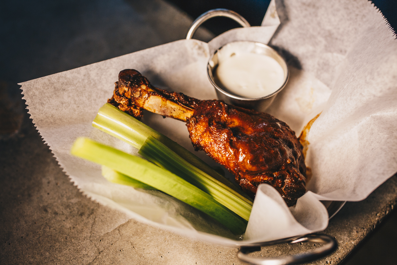 Buffalo chicken leg: a full-size chicken drumstick, fried and spun in choice of sauce / Image: Catherine Viox // Published: 2.25.19