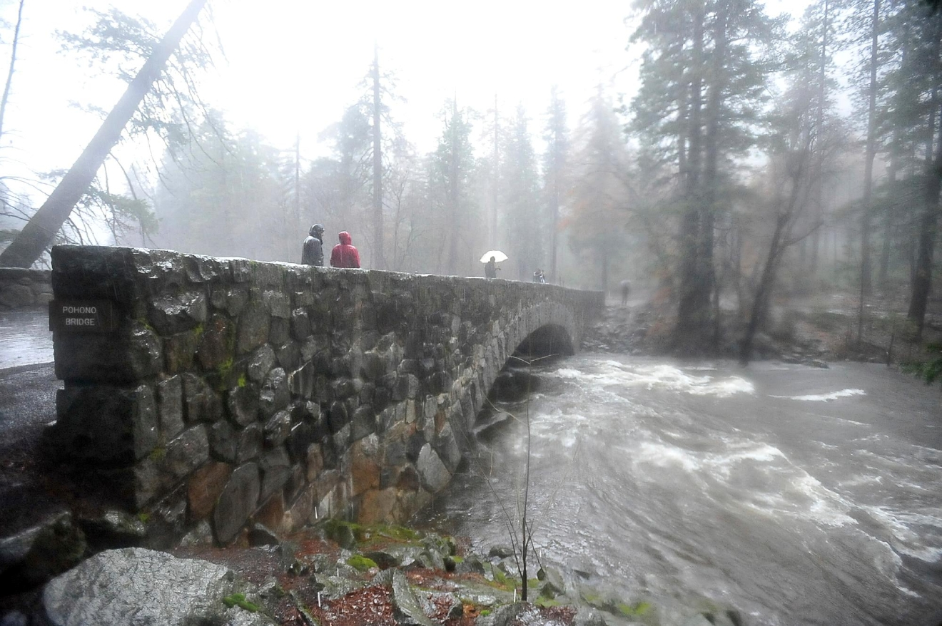 FILE - In this Jan. 8, 2017 file photo, the Merced River flows under the Pohono Bridge in Yosemite National Park, Calif.  More than 40 percent of California has emerged from a punishing drought that covered the whole state a year ago, federal drought-watchers said Thursday, Jan. 12 a stunning transformation caused by an unrelenting series of storms in the North that filled lakes, overflowed rivers and buried mountains in snow. (Silvia Flores/The Fresno Bee via AP, File)