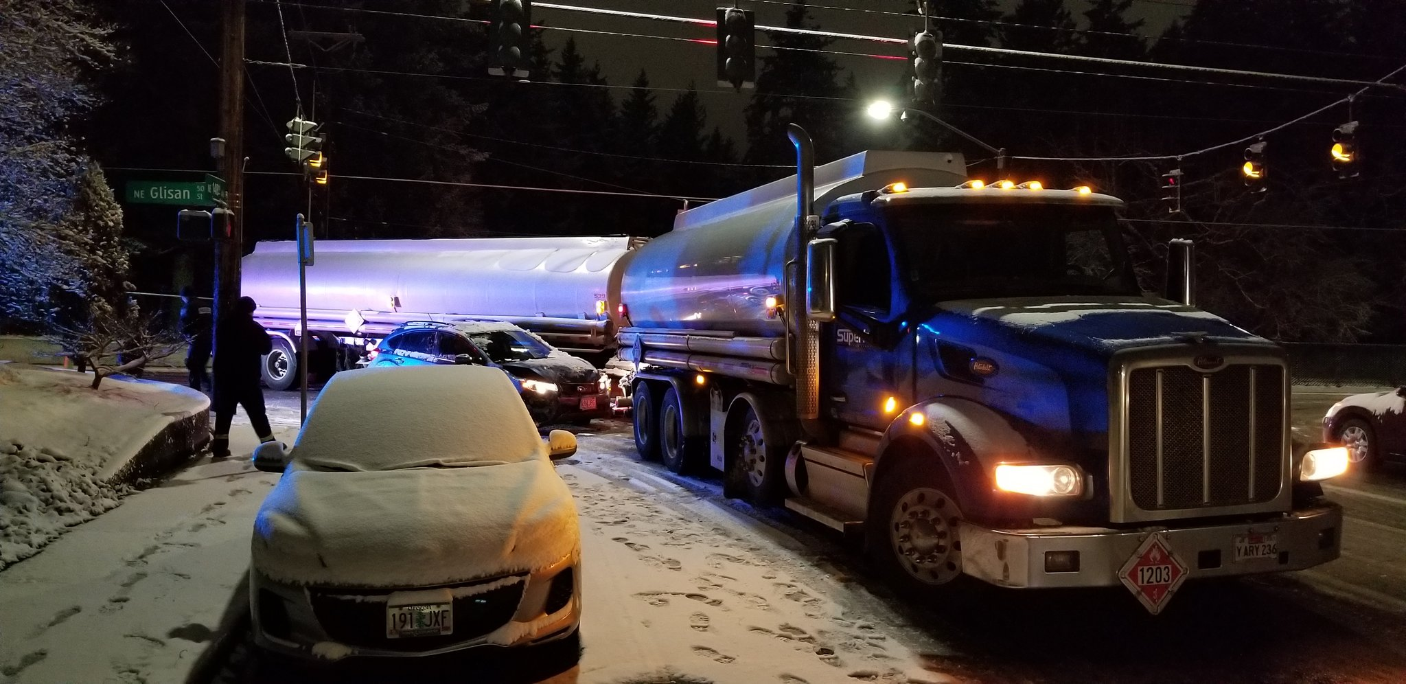 Portland Police Bureau responded to several crashes on Feb. 5, 2019 after falling snow left roads icy overnight. Many drivers slid off the road into barriers or other vehicles. This crash is at Northeast 148th Avenue and Northeast Glisan Street. Photo courtesy Portland Police Bureau