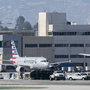 8 injured after plane clips supply truck at LA airport