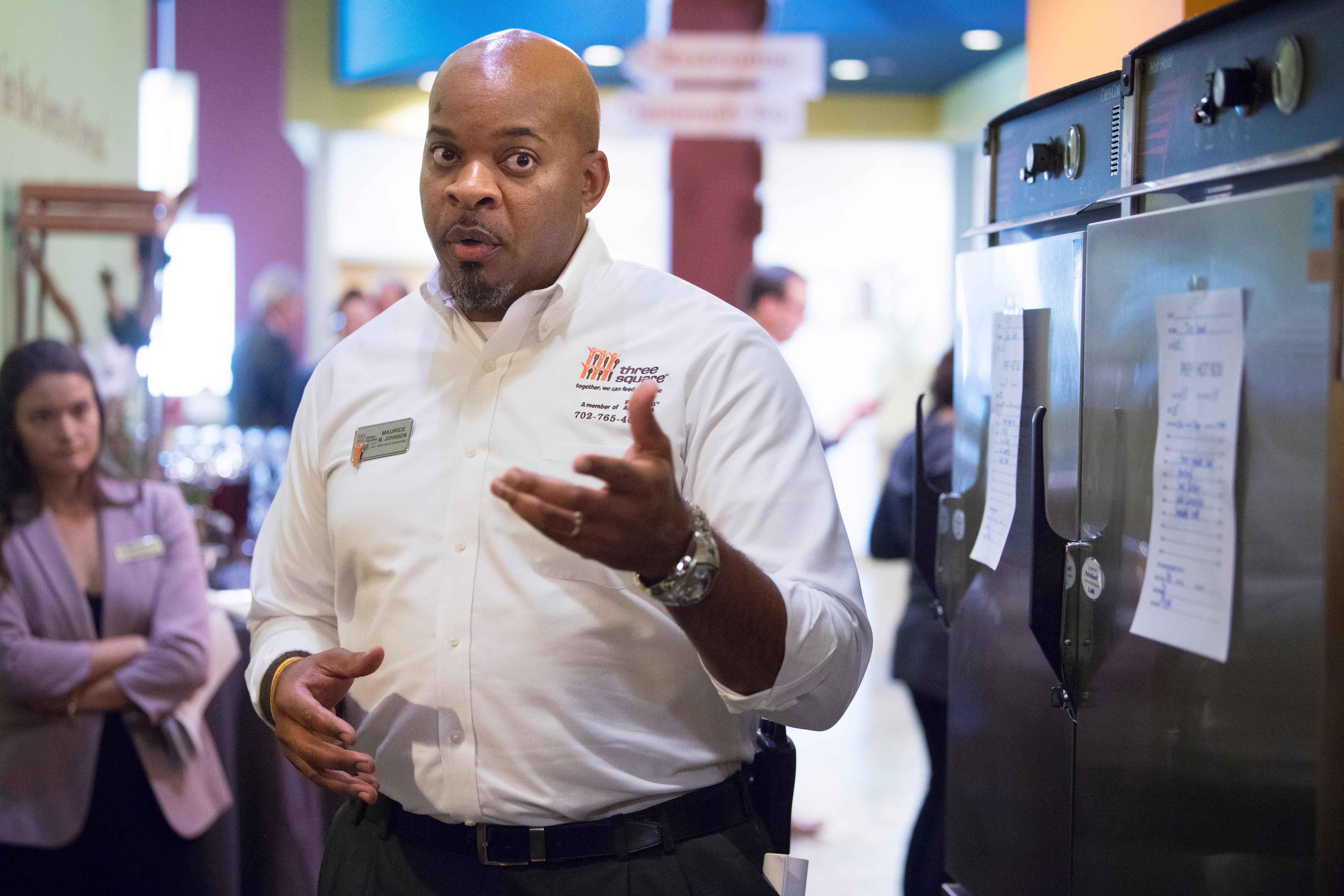 Three Square Director of Operations Maurice Johnson describes how excess banquet food is held in the hot boxes behind him during an event announcing a partnership between MGM Resorts International and Three Square food bank to expand their surplus banquet food rescue program Wednesday, January 17, 2018. CREDIT: Sam Morris/Las Vegas News Bureau