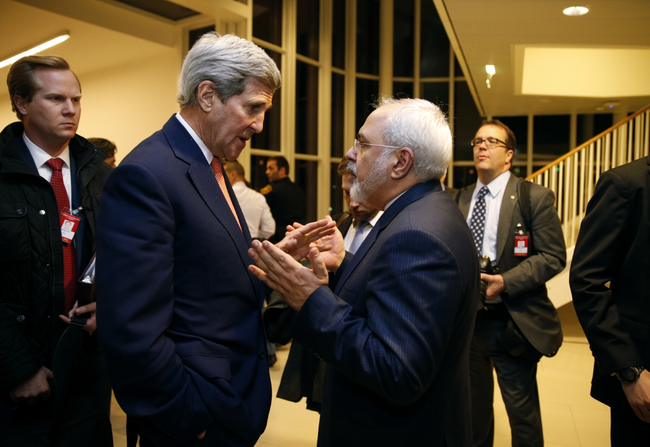 FILE - In this Jan. 16, 2016 file-pool photo, Secretary of State John Kerry talks with Iranian Foreign Minister Mohammad Javad Zarif in Vienna, after the International Atomic Energy Agency (IAEA) verified that Iran has met all conditions under the nuclear deal. (Kevin Lamarque/Pool via AP, File)<p></p>