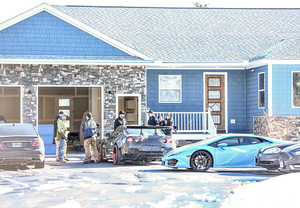 Local and federal law enforcement agents gather Tuesday morning on a house on Danville Corner Road in Auburn. This story will be updated. Police agencies are involved in actions at sites in Auburn and Lewiston. (Andree Kehn/Sun Journal)