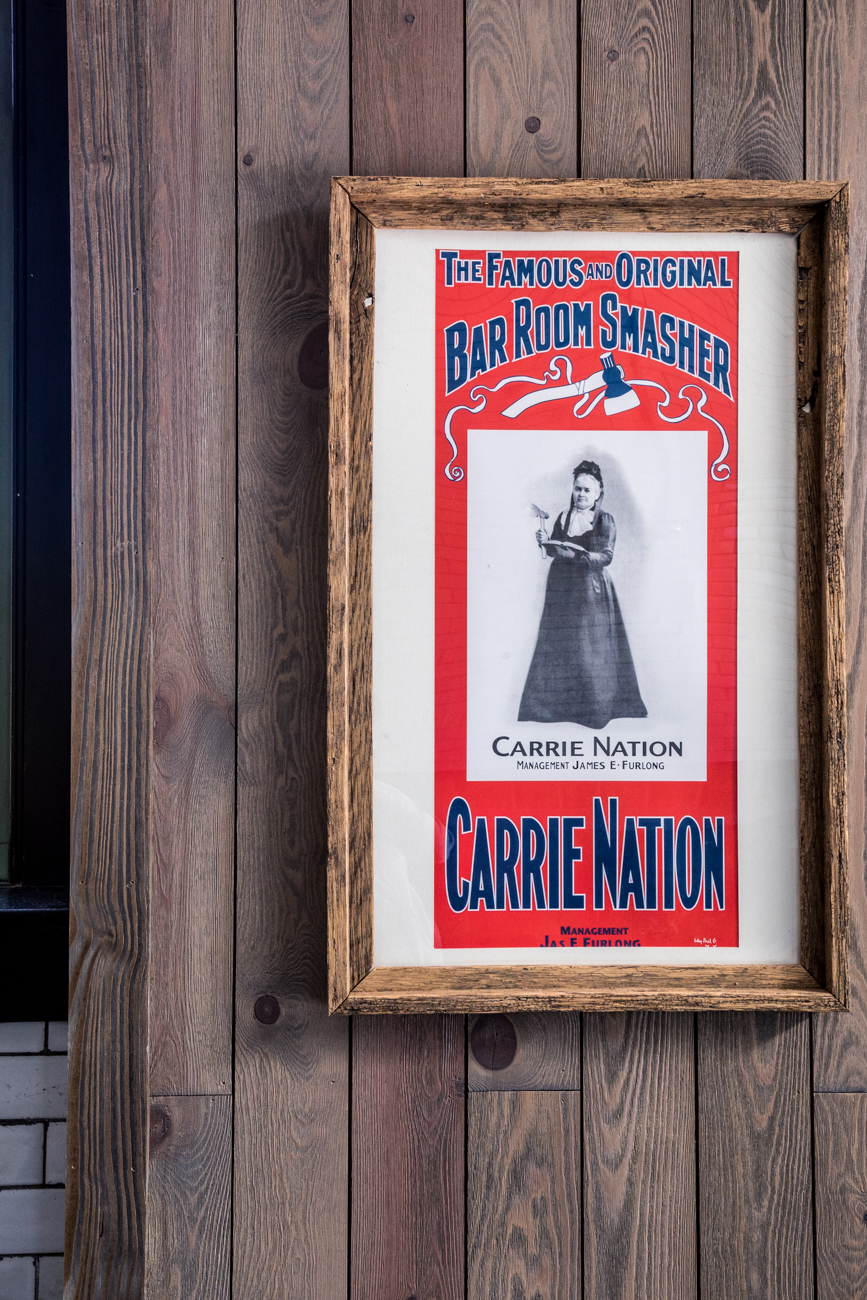 "There are plenty of references to the restaurant's mascot, Carrie Nation, at the Westwood location, too. The Kentucky native is known for ravaging bars across America with a hatchet in-hand during the Prohibition Era. She claimed divine ordinance while smashing any bar she crossed. After 30 arrests, Carrie arrived in Cincinnati, stepped onto Vine Street, and then immediately turned around, allegedly claiming she would have ""dropped from exhaustion before I went one block for all the bars in this city."" An additional nod to local history is the Westwood building itself, which is the old Engine Co. Number 35 firehouse. / Image: Catherine Viox // Published: 11.7.20"