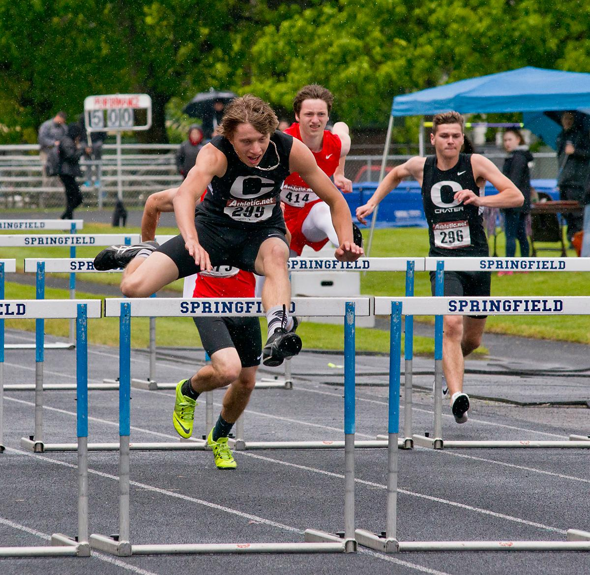 Cal Duke, from Crater, wins the 110 meter hurdles with a time of 15.61 at the 5A-3 Midwestern League District Track Meet. Photo by Dan Morrison, Oregon News Lab