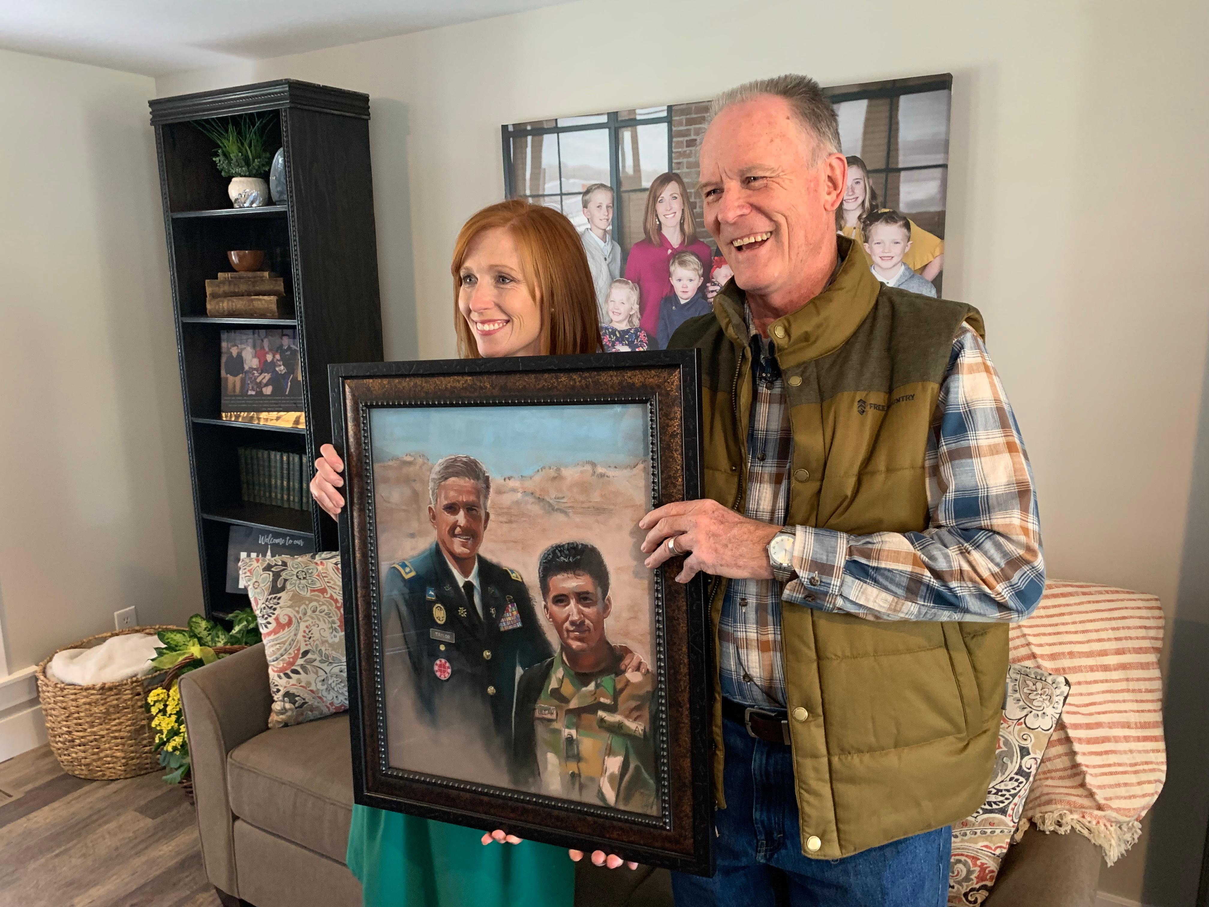 Utah artist J.R. Johansen hand-delivered a custom portrait of Major Brent Taylor to his wife, Jennie, on Friday, November 16, 2018. (Photo: Dan Rascon / KUTV)