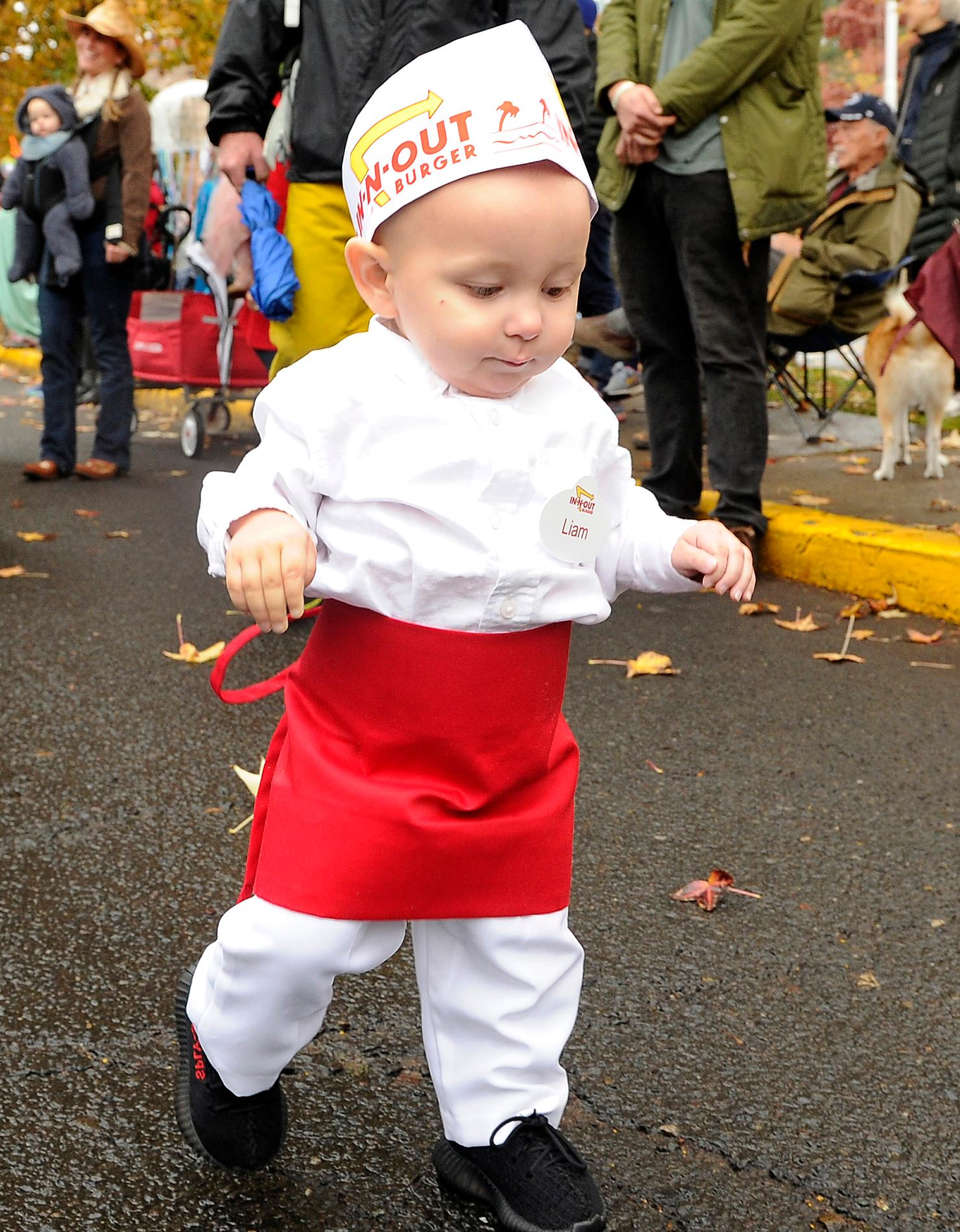 Andy Atkinson / Daily Tidings <br>One-year-old Liam McComas makes his way through downtown Ashland during the annual Halloween parade.