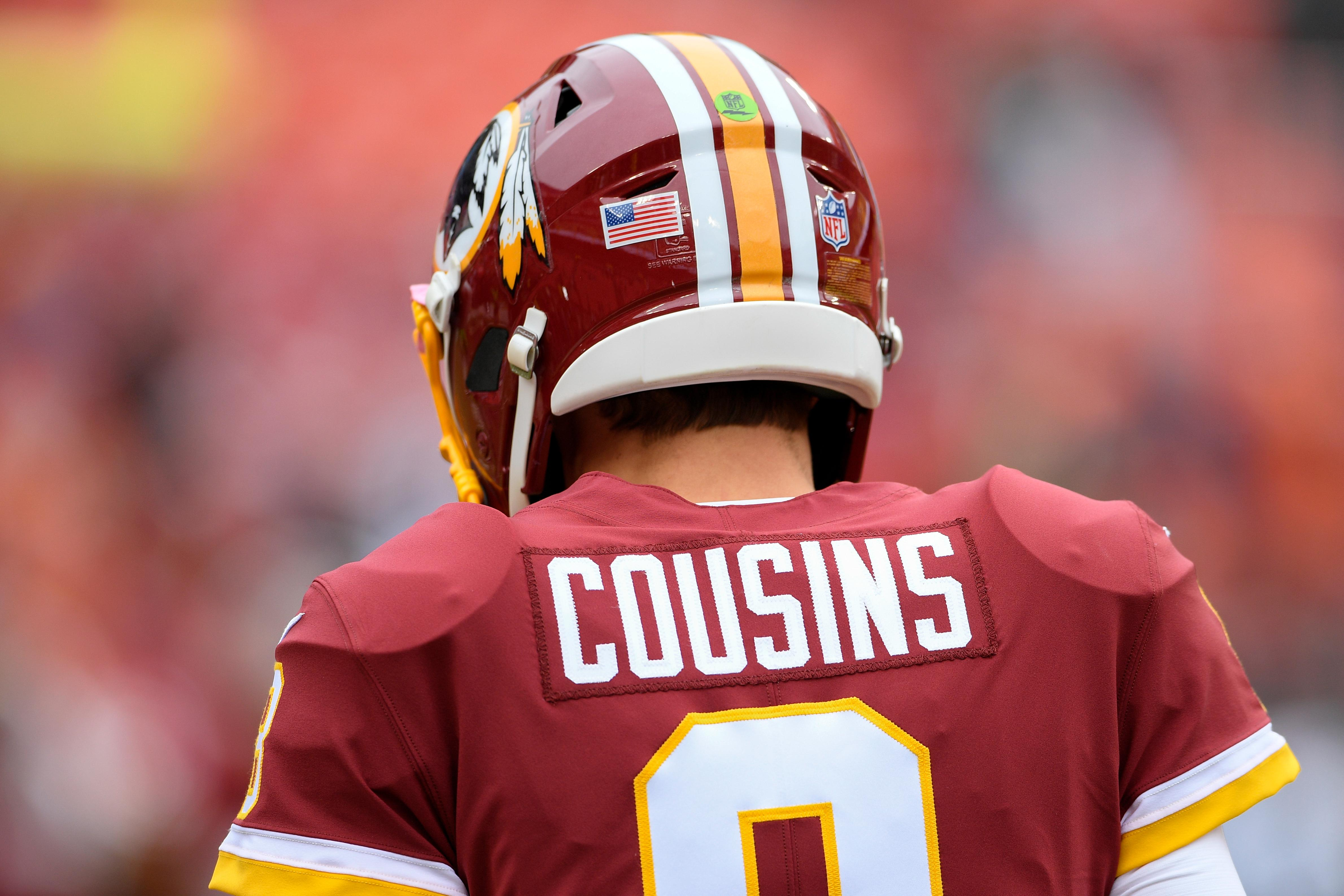 Washington Redskins quarterback Kirk Cousins (8) walks across the field before an NFL football game against the Denver Broncos in Landover, Md., Sunday, Dec 24, 2017. (AP Photo/Nick Wass)