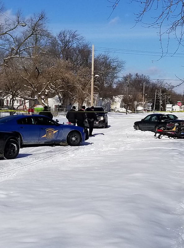 Flint Police are investigating a car vs snowmobile crash in Flint on the corner of Woodrow and Curry Street. Man driving snowmobile in critical condition. (Photo courtesy of Sheri Ketchum)