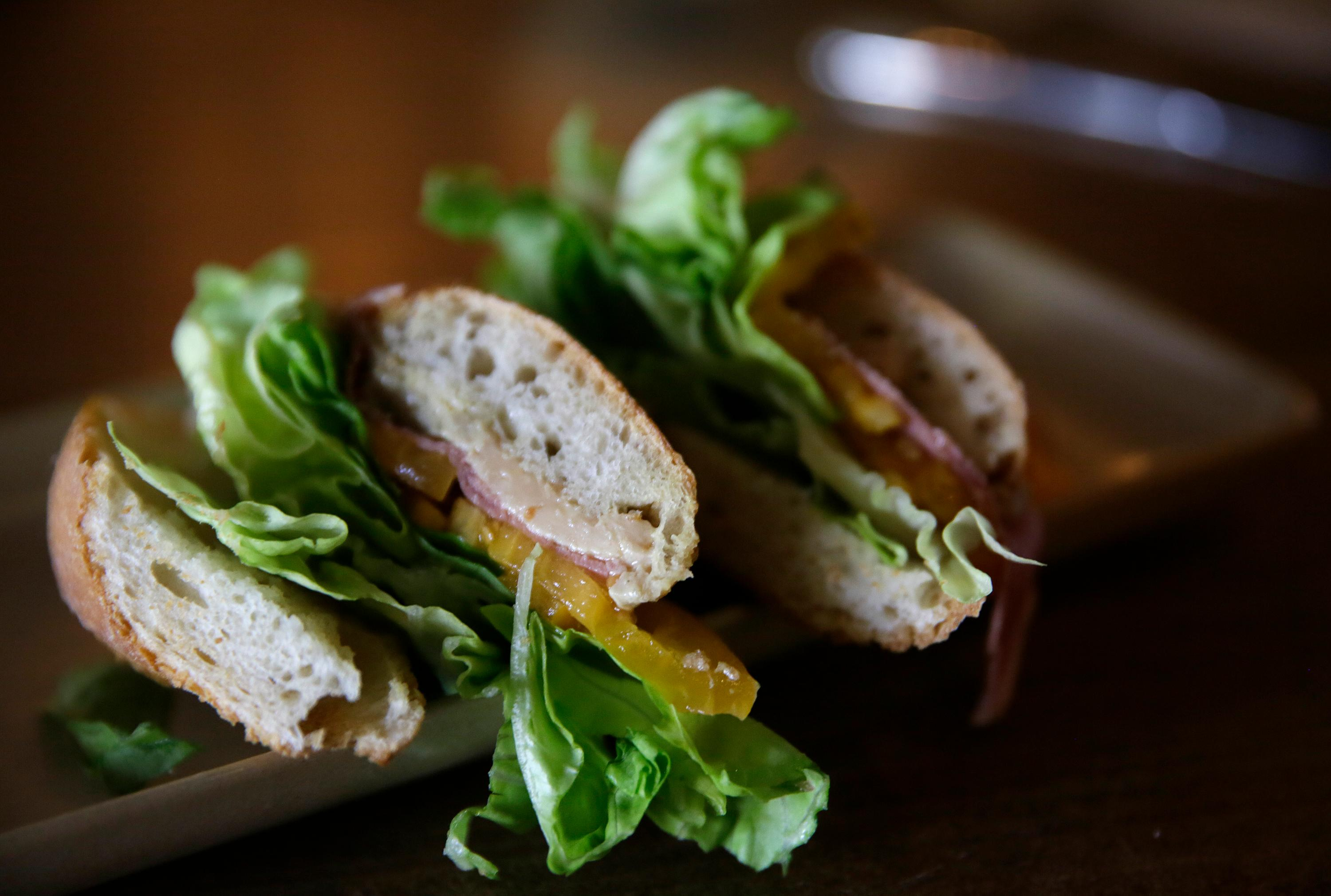 A Foie Gras Torchon sandwich is seen after being served at the Naked Lunch restaurant Friday, Sept. 15, 2017, in San Francisco. (AP Photo/Eric Risberg)
