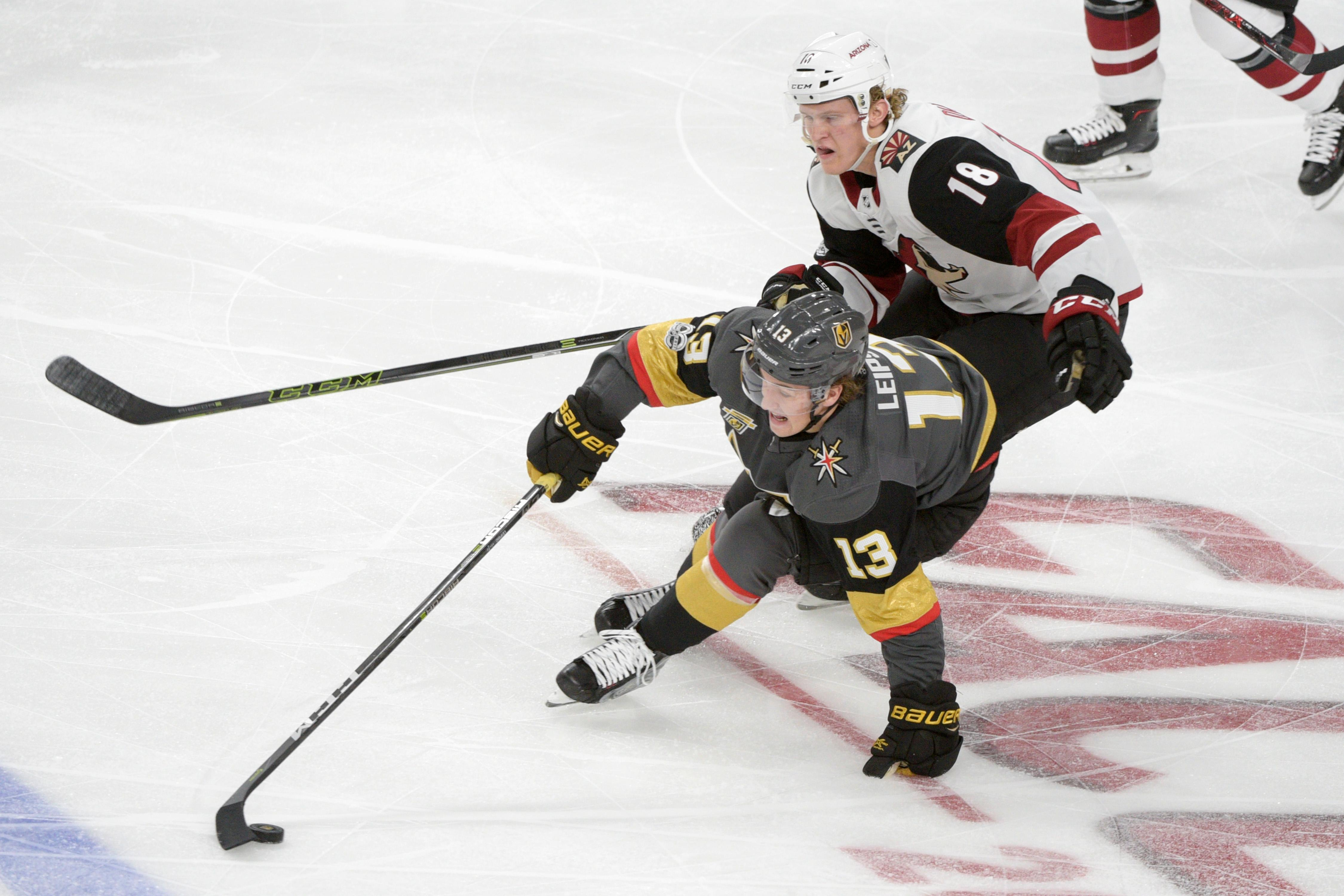 Vegas Golden Knights right wing Brendan Leipsic (13) keeps the puck away from Arizona Coyotes center Christian Dvorak (18) during the Knights home opener Tuesday, Oct. 10, 2017, at the T-Mobile Arena. The Knights won 5-2 to extend their winning streak to 3-0. CREDIT: Sam Morris/Las Vegas News Bureau