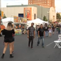 People attending Downtown Street Fest despite record-breaking heat