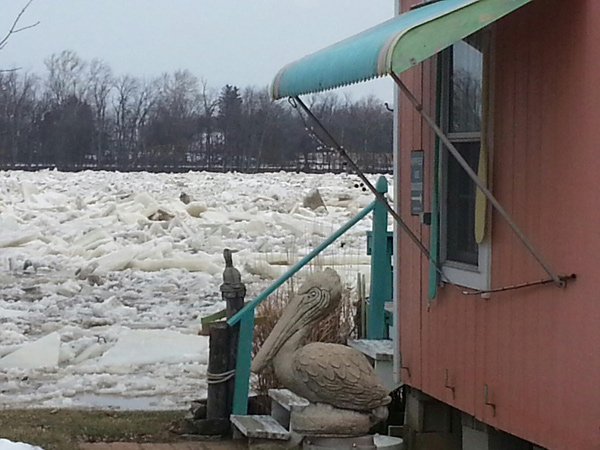 An ice jam along the Maumee River threatens homes and other structures.