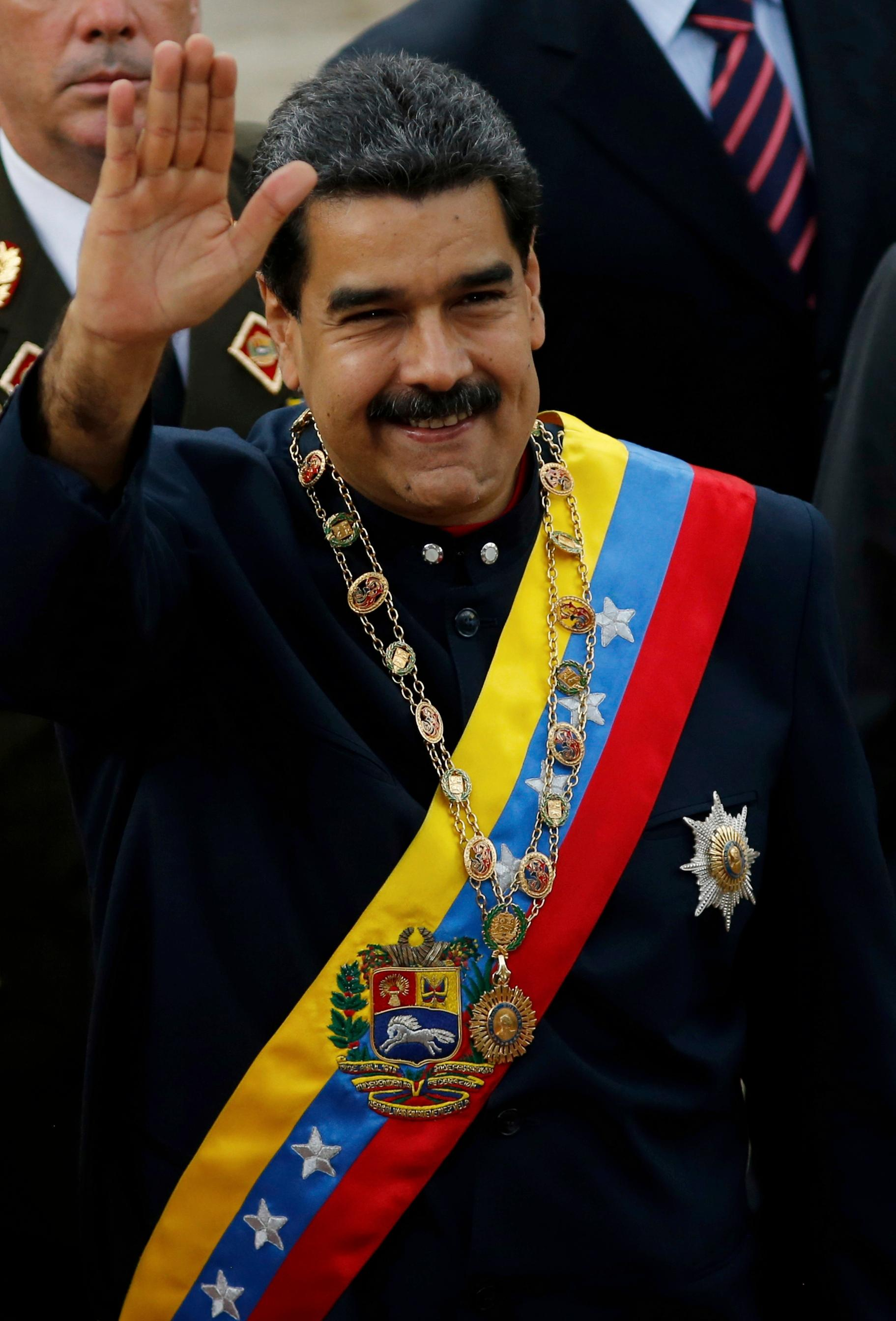 Venezuela's President Nicolas Maduro waves upon arrival to the National Assembly building to attend a session of the Constitutional Assembly in Caracas, Venezuela, Thursday, Aug. 10, 2017. The new constitutional assembly has declared itself as the superior body to all other governmental institutions. (AP Photo/Ariana Cubillos)